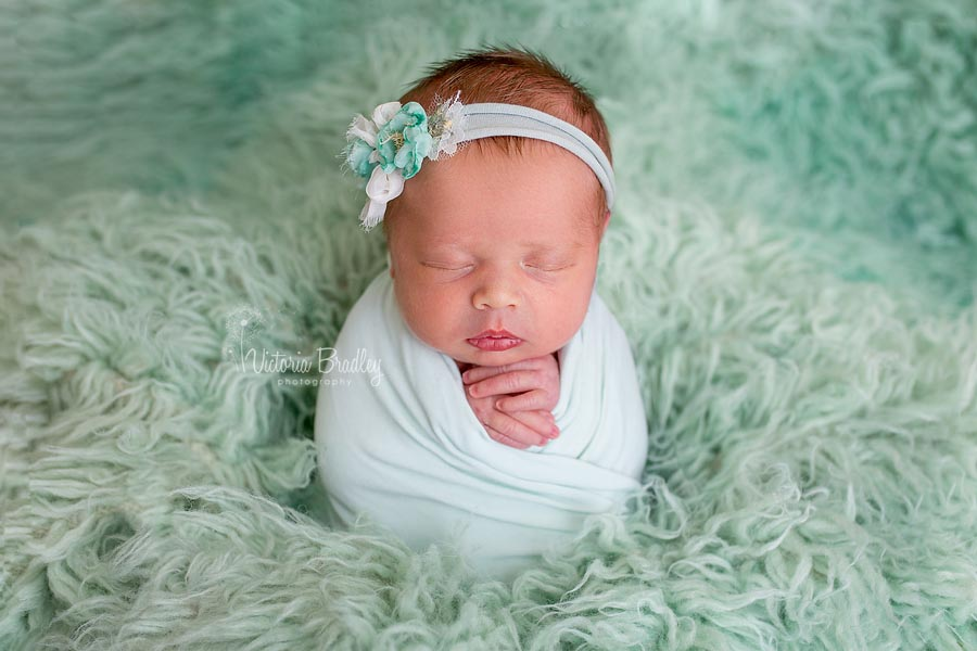Newborn Potato Sack Pose, minty greens, baby girl