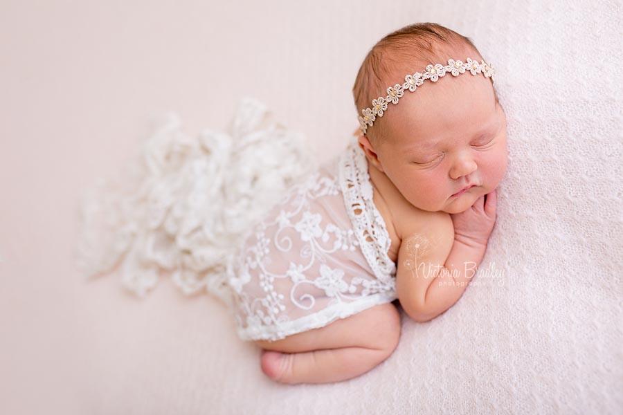 newborn photography on pale pink backdrop