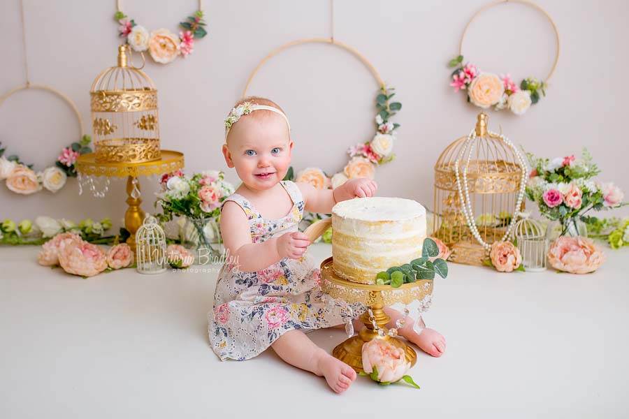 baby girl cake smash, floral flowers theme, gold bird cages and flower hoops