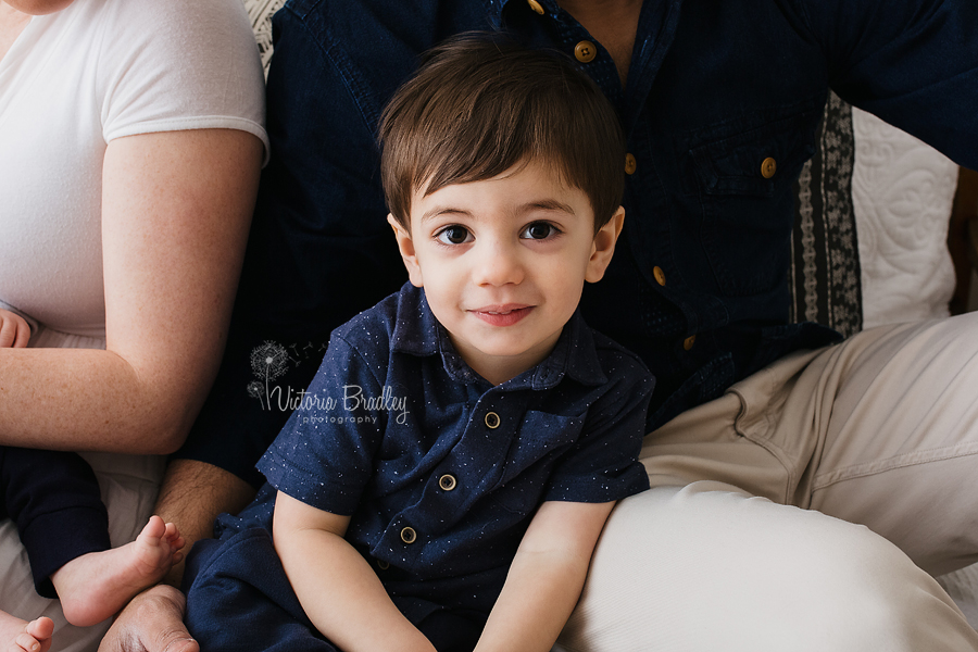 toddler boy with family in blue shirt