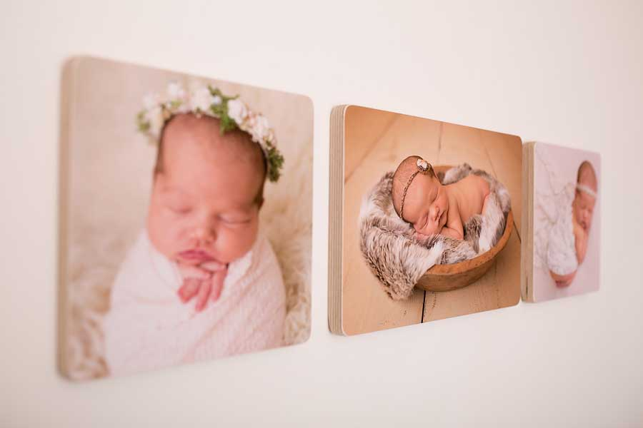 a set of handmade birchwood photo blocks with images of babys