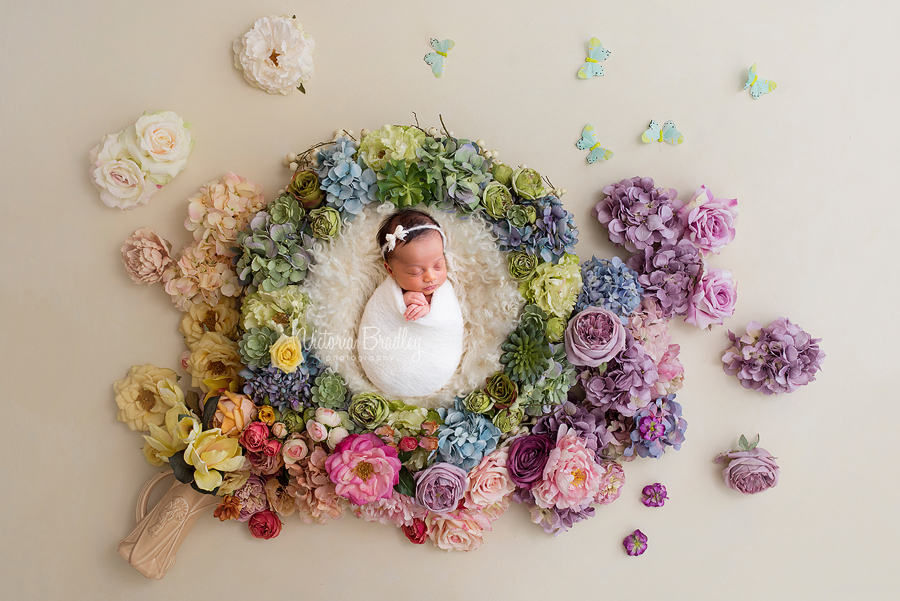 floral newborn baby girl in flower basket
