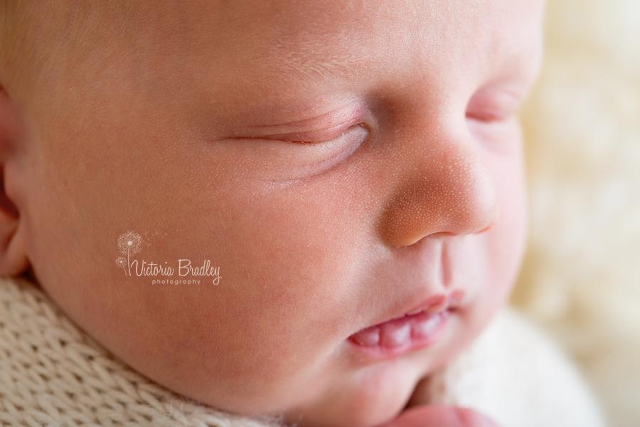 macro of newborns face