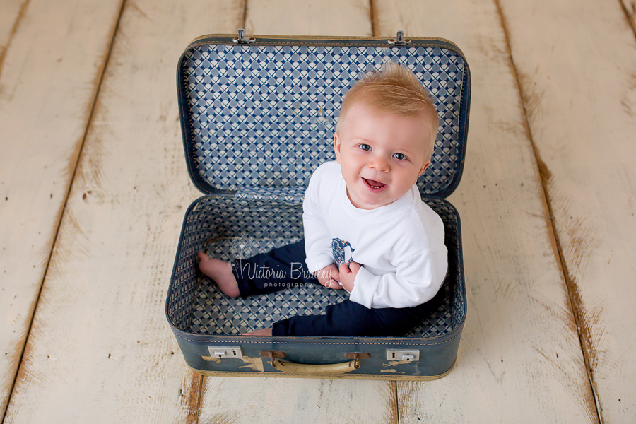 sitter baby boy in vintage blue suitcase