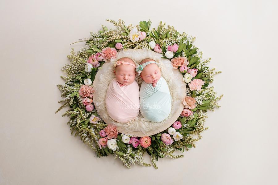 cousin newborns in flower basket