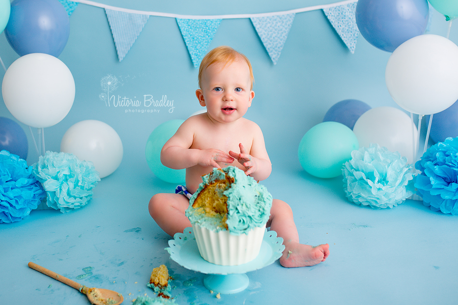baby boy cake smash session with blue giant cupcake