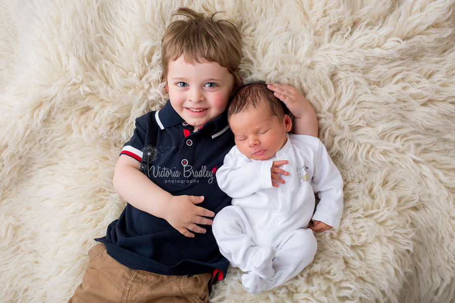 baby newborn with 3 years old sibling photography session in Nottinghamshire