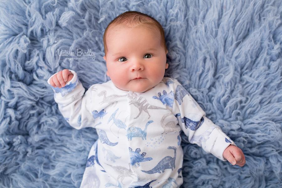 baby bot on blue flokati rug
