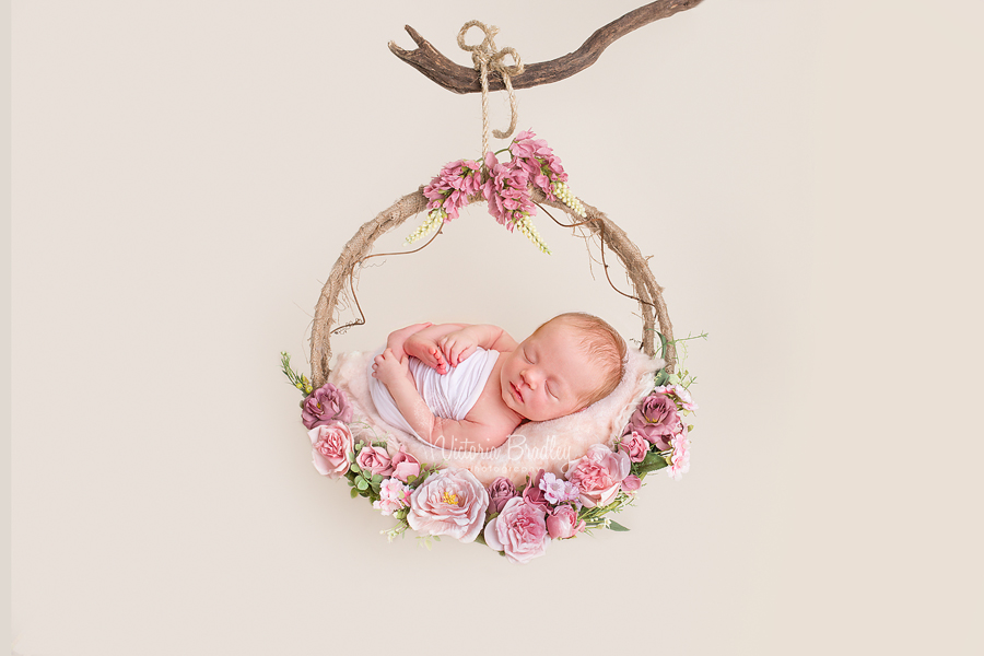 wrapped newborn photography  on swing
