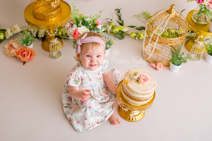 floral baby girl cake smash, bird cages, flowers, baby girl