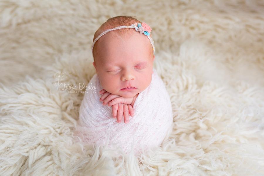Baby potato sack pose baby girl