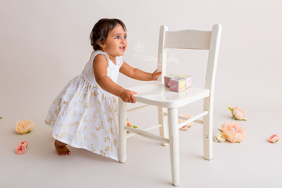 cake smash photography baby girl with white chair