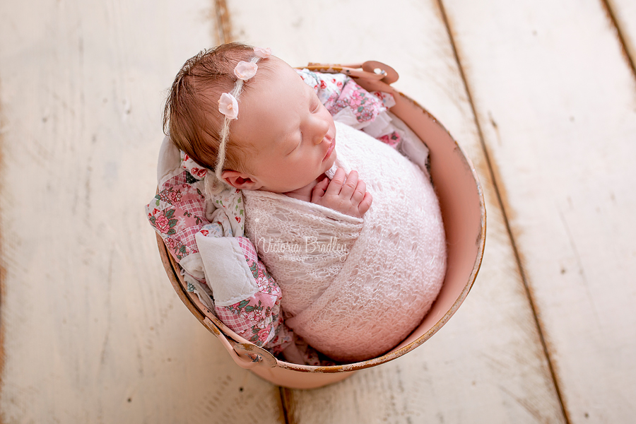 wrapped newborn photography baby in bucket