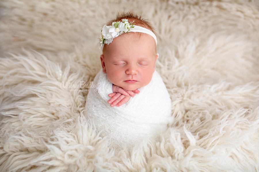 potato sack pose with newborn girl
