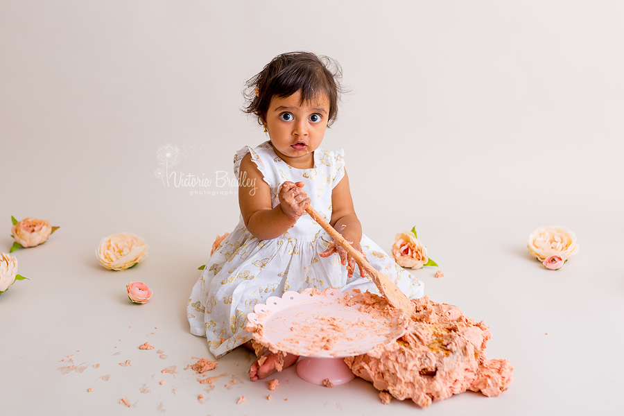 cake smash photography baby girl with wooden spoon