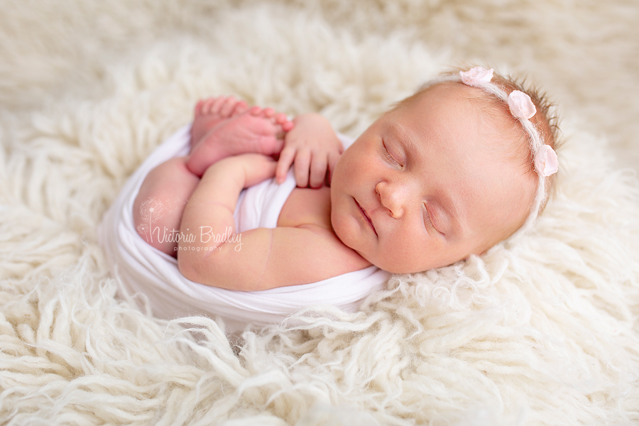 wrapped baby newborn photography