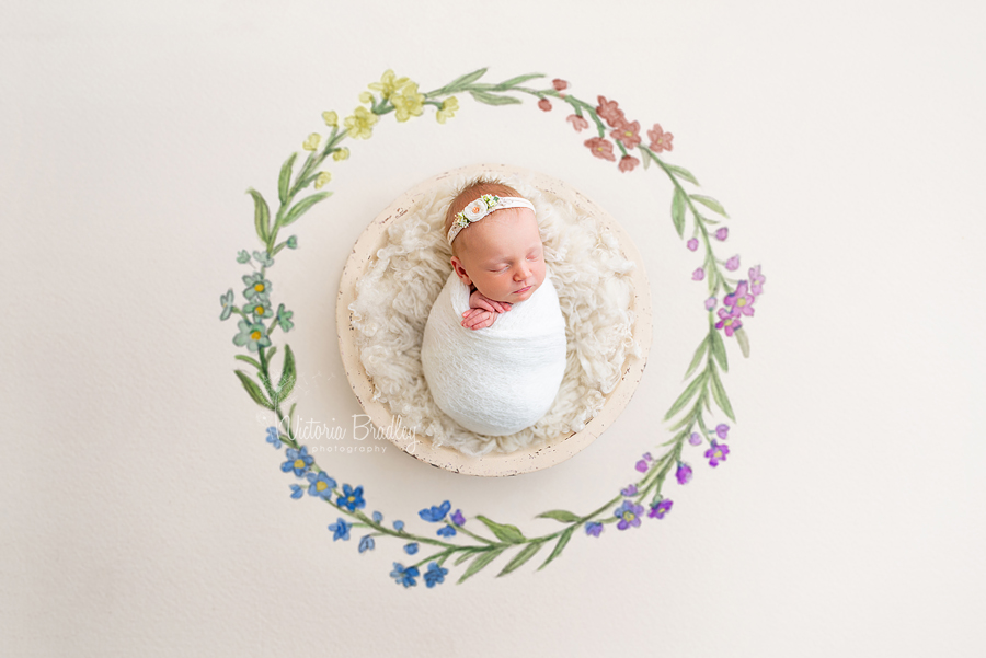 wrapped newborn baby girl, painted flowers