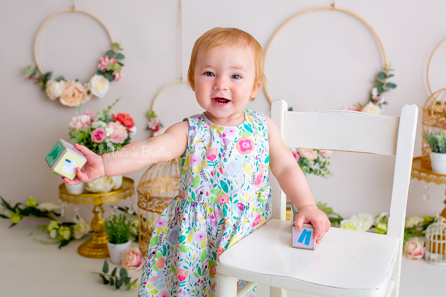 baby girl cake smash floral set with blocks and white chair