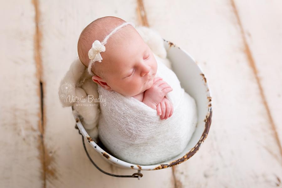 newborn baby girl photography in white bucket
