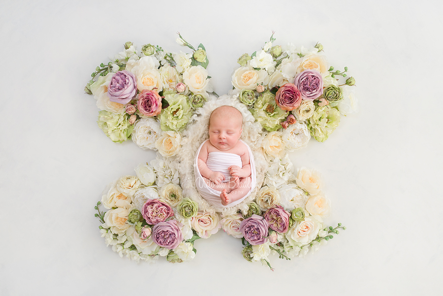 newborn baby girl photography on flower butterfly backdrop