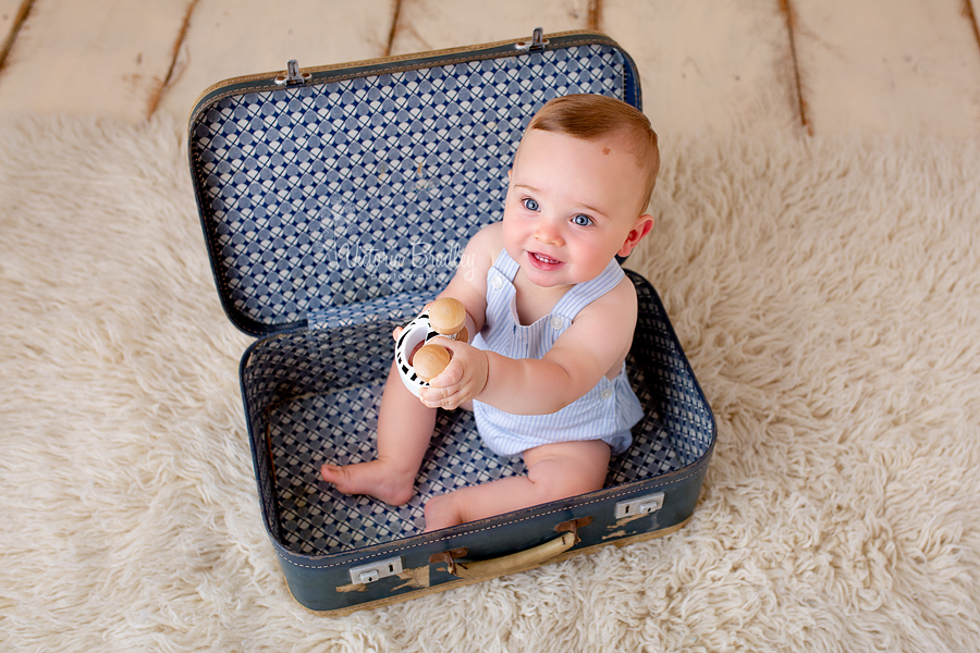sitter baby boy photography in suitcase