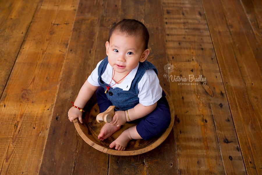 baby boy in wooden bowl