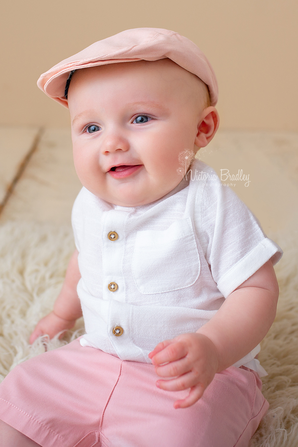 baby photography session with flat cap
