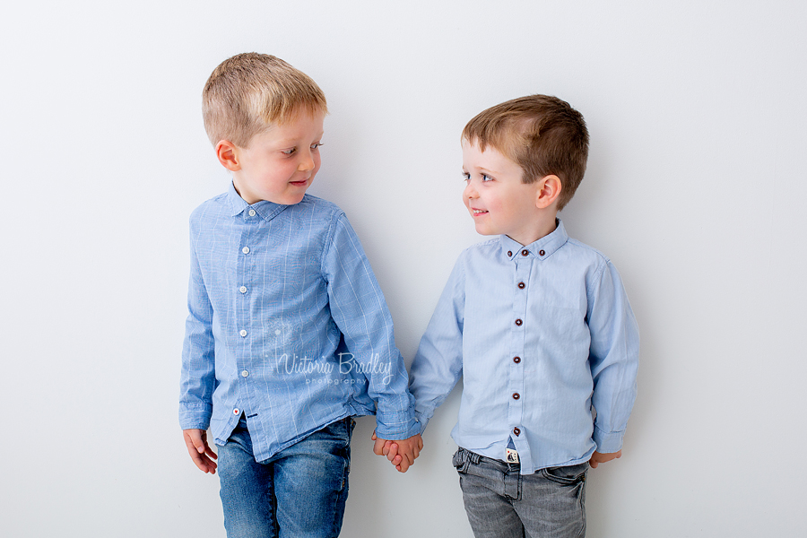 sibling photography white studio boys