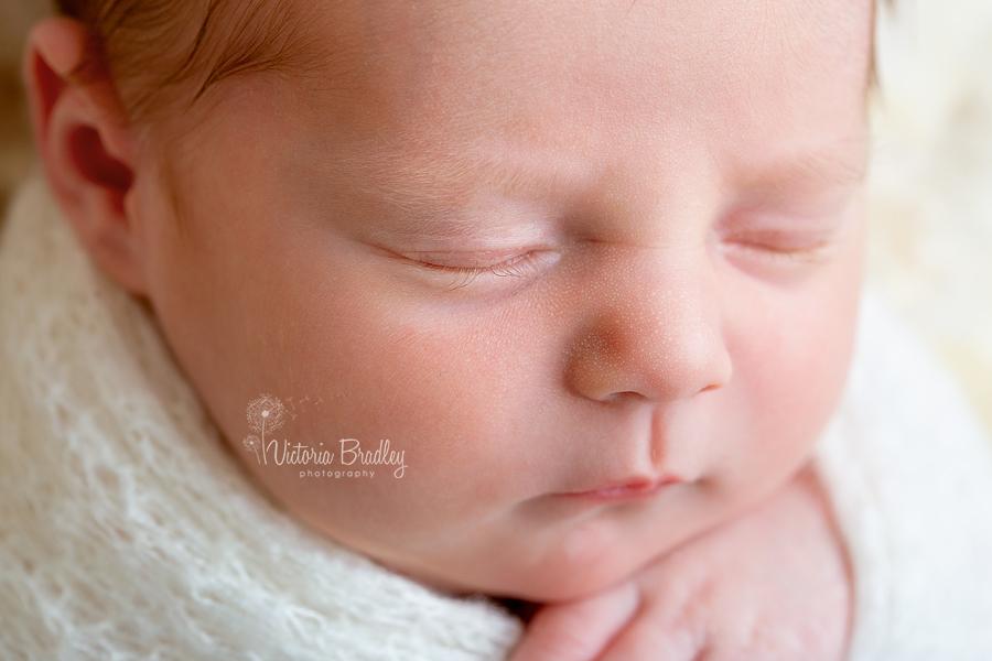 macro of newborn baby girl lashes
