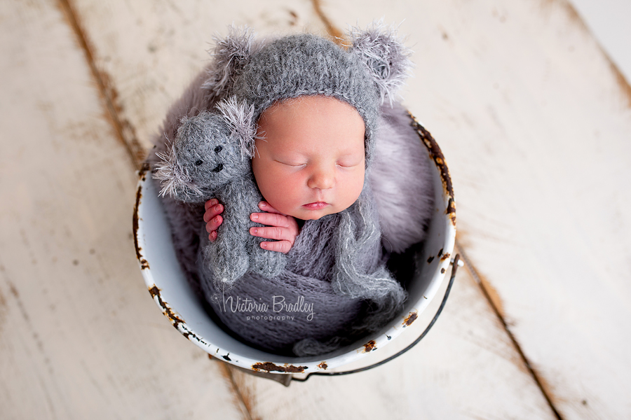 baby in koala hat with tiny koala bear