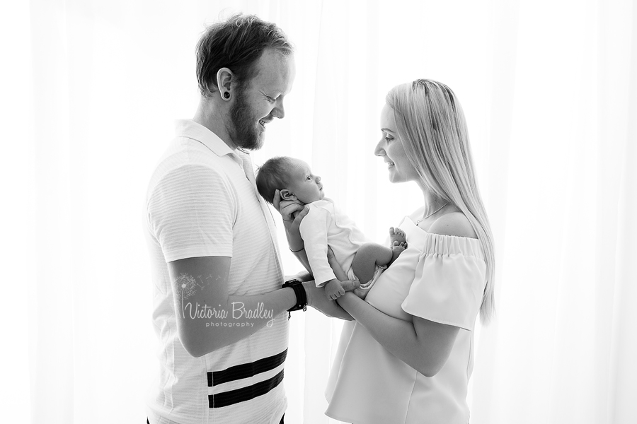 family and newborn photograph in black and white