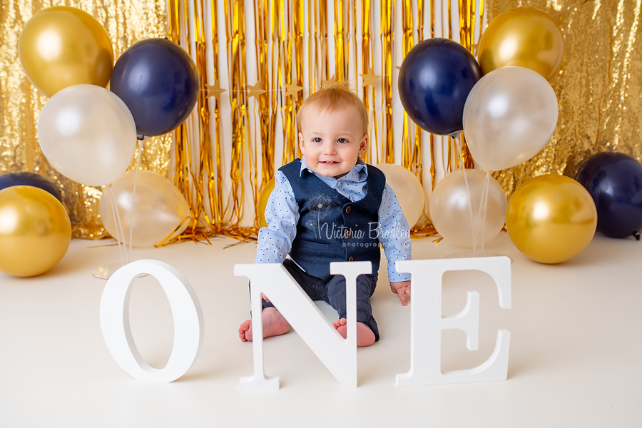 gold and navy cake smash session photography