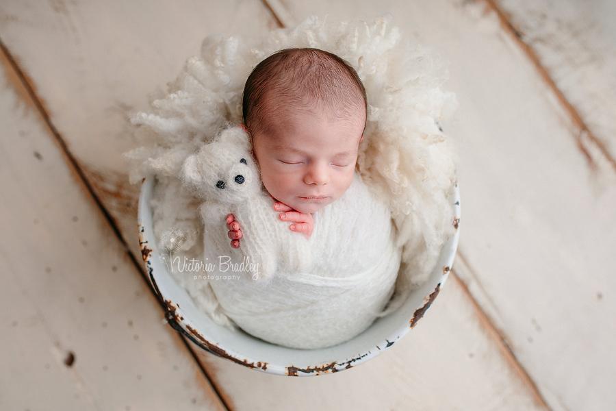 newborn baby photography in metal bucket