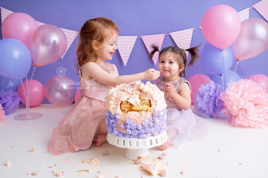 baby girl cake smash pinks and purples