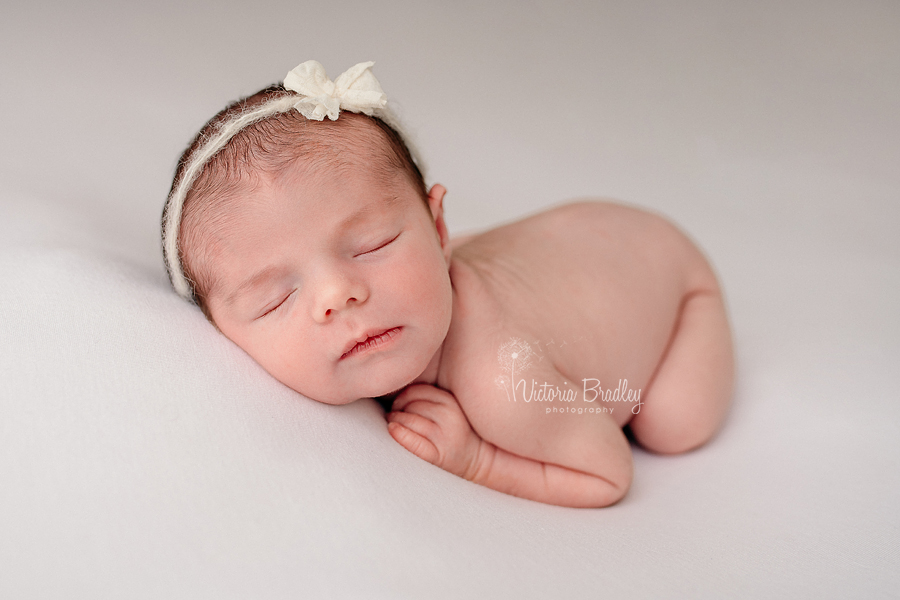 newborn baby photography on white backdrop