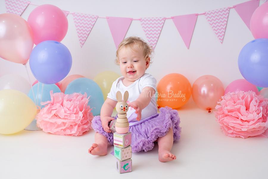 macaroon pastel cake smash baby girl rainbow