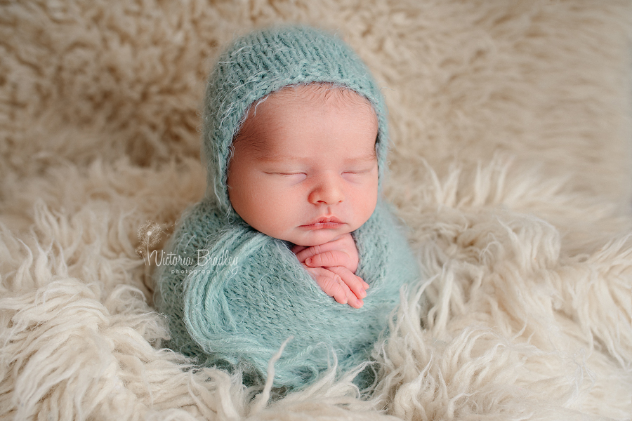 potato sack pose newborn photography sage green fluffy wrap