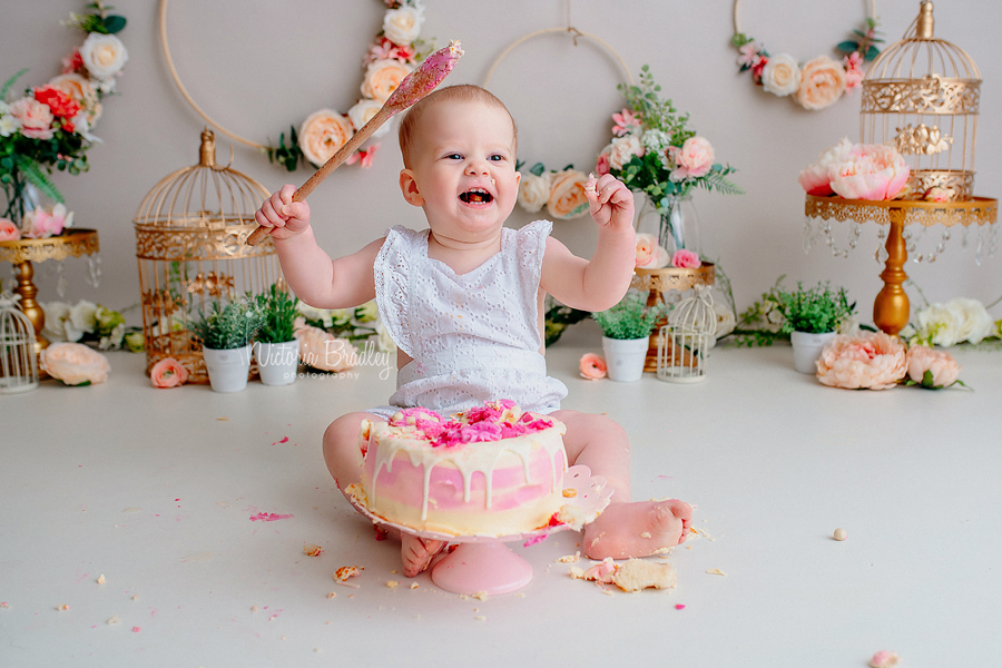 baby with wooden spoon cake smash