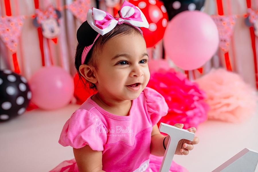 baby girl pink and black cake smash