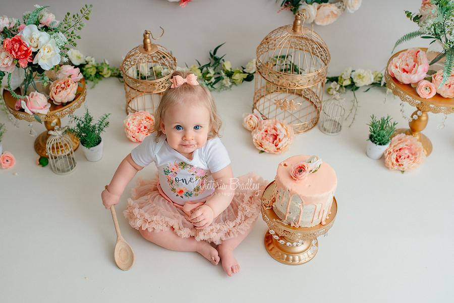 baby girl cake smash peach flowers