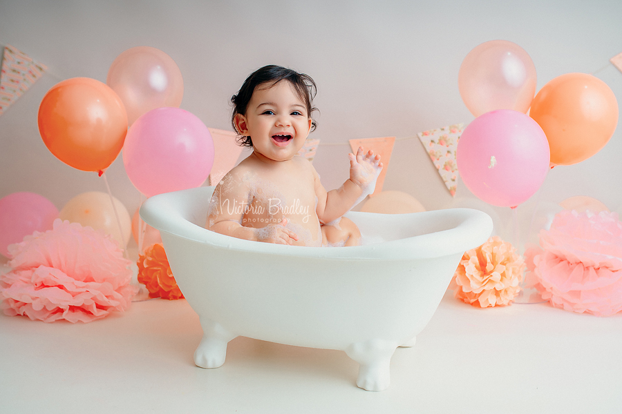 baby girl in white bath tub photography