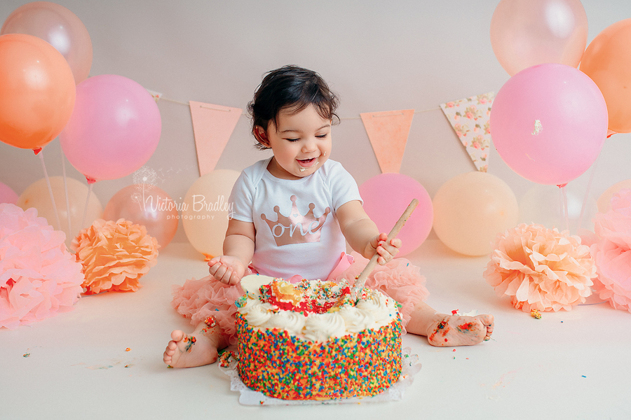 baby girl peach and pale pink cake smash