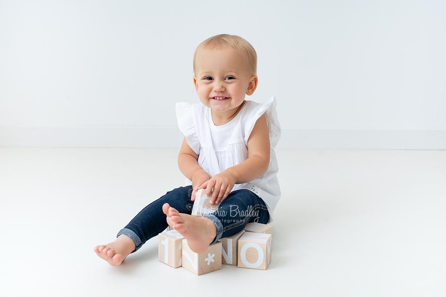 toddler on white backdrop