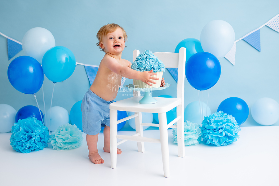 baby boy blues cake smash with white chair