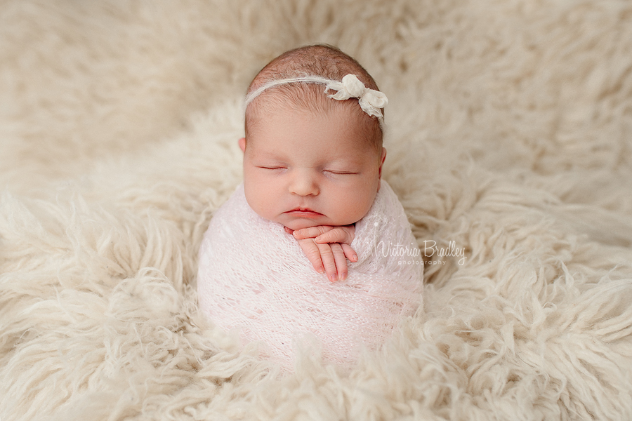 potato sack pose newborn baby girl