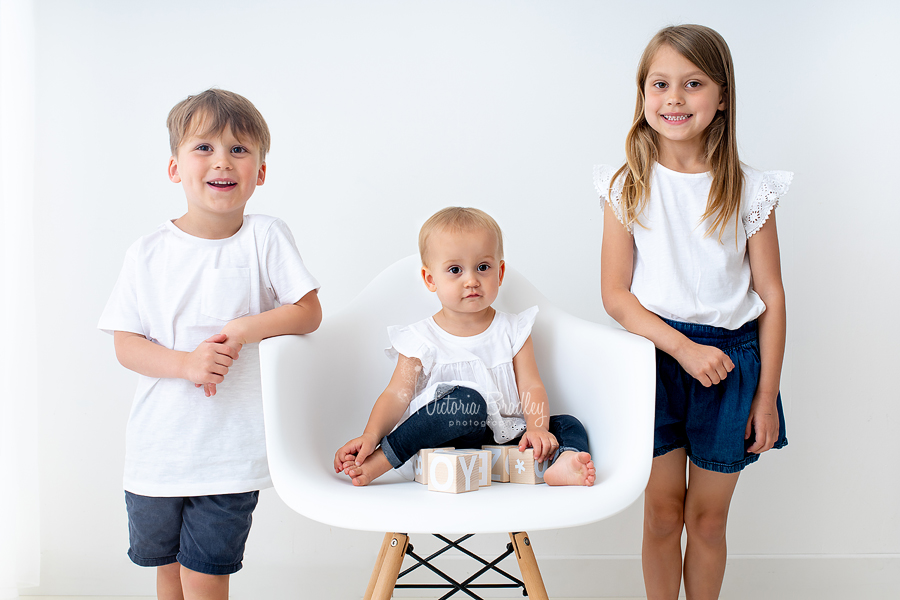 toddler and siblings on Eiffel chair