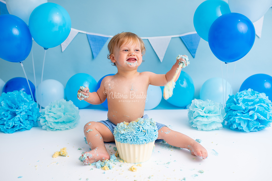 cake smash with baby boy and wooden spoon