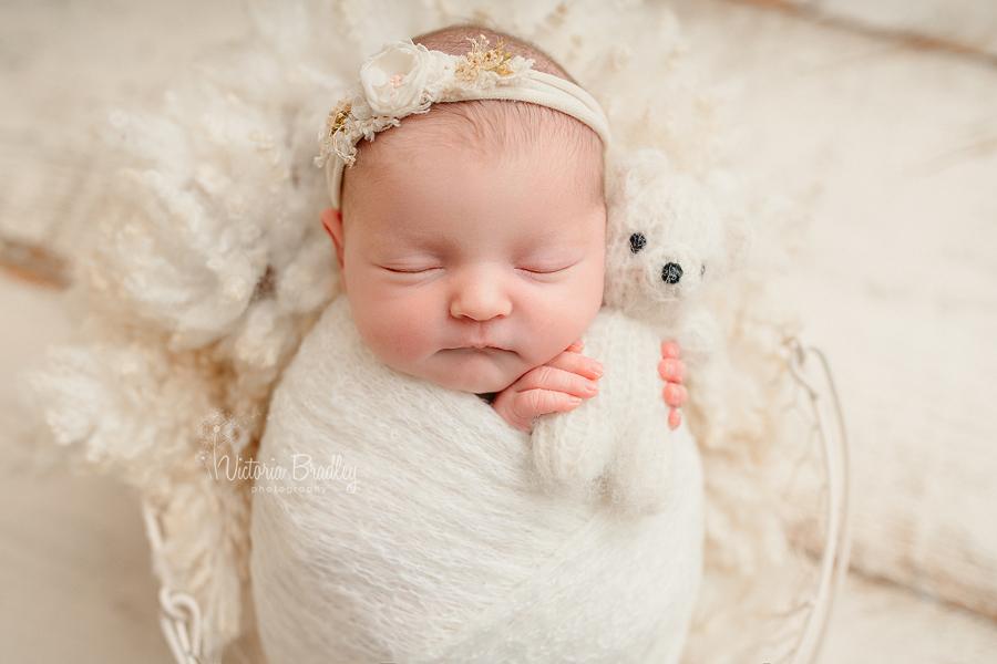 wrapped newborn with teddy
