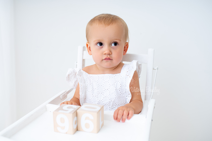 baby in white high chair