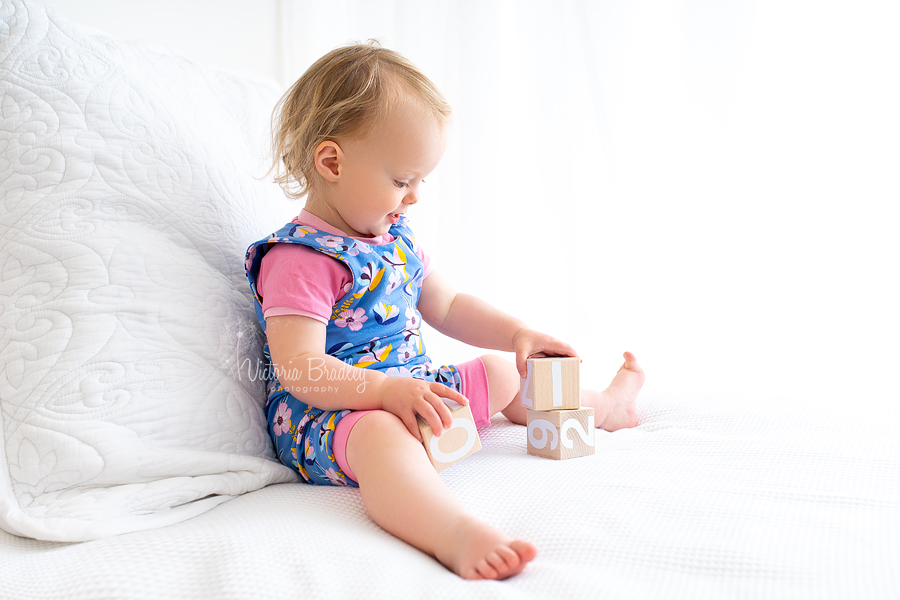 toddler photography on white bed
